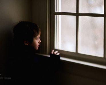 boy-looking-out-a-window-by-Celeste-Pavlik-840x560